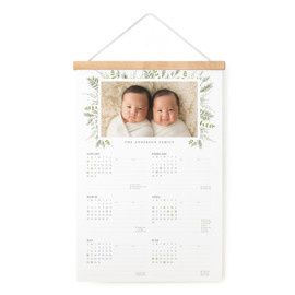 This is a white hanging bar calendar by Susan Moyal called Bed of Greens with standard printing on signature in one-page calendar.