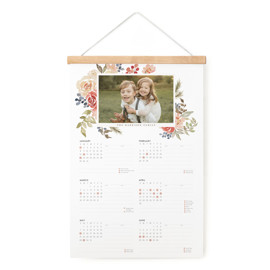 This is a pink hanging bar calendar by Wildfield Paper Co. called Bright Holiday Garden with standard printing on signature in one-page calendar.