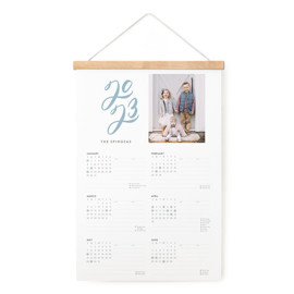 This is a blue hanging bar calendar by Up Up Creative called Unexpected with standard printing on signature in one-page calendar.