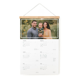 This is a white hanging bar calendar by Toast & Laurel called Pencil It In with standard printing on signature in one-page calendar.