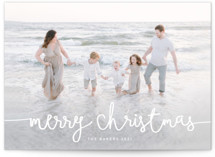 This is a white holiday photo card by Melanie Severin called Playful Script with standard printing on smooth signature in grand.