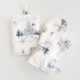 This is a blue apron by Surface Love called Texas Modern Toile in standard.