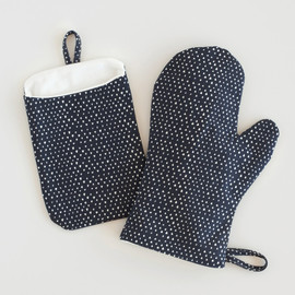 This is a blue apron by CedarandGrey called Tiny Triangle in standard.