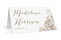 This is a gold wedding place card by Phrosne Ras called Engraved Flowers with foil-pressed printing on signature in placecard.