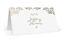 This is a gold wedding place card by Chris Griffith called Black Tie Wedding with foil-pressed printing on signature in placecard.