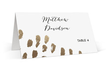 This is a gold wedding place card by Aspacia Kusulas called Brushworks with foil-pressed printing on signature in placecard.