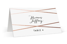 This is a rosegold wedding place card by Bethany Anderson called Crossed with foil-pressed printing on signature in placecard.