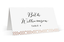 This is a rosegold wedding place card by Hooray Creative called Moderna with foil-pressed printing on signature in placecard.
