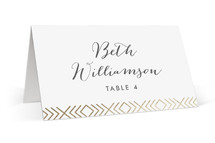 This is a gold wedding place card by Hooray Creative called Moderna with foil-pressed printing on signature in placecard.