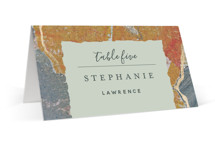 This is a orange wedding place card by Starry Lane Studio called Earth Song with foil-pressed printing on signature in placecard.