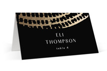 This is a black wedding place card by AK Graphics called Prism with foil-pressed printing on signature in placecard.