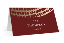 This is a red wedding place card by AK Graphics called Prism with foil-pressed printing on signature in placecard.