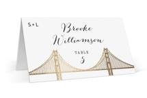 This is a white wedding place card by Hooray Creative called Golden Gate Bridge with foil-pressed printing on signature in placecard.