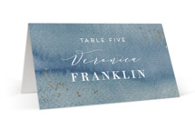 This is a blue wedding place card by Alexandra Dzh called Abstract seaside with foil-pressed printing on signature in placecard.