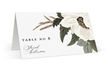 This is a green wedding place card by Susan Moyal called Floral Sweep with foil-pressed printing on signature in placecard.
