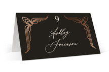 This is a black wedding place card by GeekInk Design called Geometric Deco with foil-pressed printing on signature in placecard.