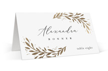 This is a white wedding place card by Laura Hankins called Vine + Pen with foil-pressed printing on signature in placecard.