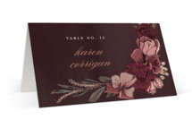 This is a red wedding place card by Susan Moyal called Verdigris with foil-pressed printing on signature in placecard.