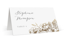 This is a gold wedding place card by Smudge Design called Gilded Wildflowers with foil-pressed printing on signature in placecard.