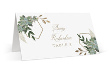 This is a white wedding place card by Susan Moyal called Succulent Surround with foil-pressed printing on signature in placecard.