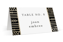 This is a black wedding place card by Melanie Kosuge called ALEXA with foil-pressed printing on signature in placecard.