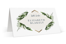 This is a green wedding place card by Leah Bisch called Diamante with foil-pressed printing on signature in placecard.