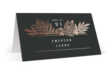 This is a black wedding place card by Alethea and Ruth called Fern Frame with foil-pressed printing on signature in placecard.