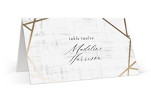 This is a gold wedding place card by Poi Velasco called Gilded Concrete with foil-pressed printing on signature in placecard.