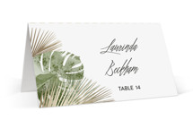 This is a gold wedding place card by shoshin studio called Palm Springs with foil-pressed printing on signature in placecard.