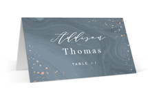 This is a grey wedding place card by Hooray Creative called Moody Marbling with foil-pressed printing on signature in placecard.