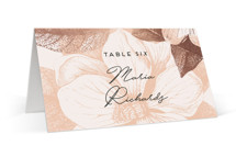 This is a pink wedding place card by Design Lotus called The Land of Magnolias with foil-pressed printing on signature in placecard.