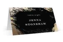 This is a black wedding place card by Kimberly FitzSimons called Edgy Charm with foil-pressed printing on signature in placecard.