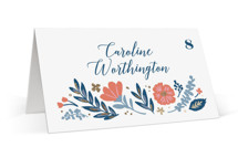 This is a blue wedding place card by Hooray Creative called Folk Floral with foil-pressed printing on signature in placecard.