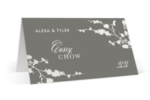 This is a grey wedding place card by Three Kisses Studio called In Bloom with gloss-press printing on signature in placecard.