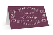 This is a purple wedding place card by Hooray Creative called Flourish with standard printing on signature in placecard.