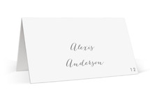This is a grey wedding place card by Bourne Paper Co. called On An Angel with standard printing on signature in placecard.