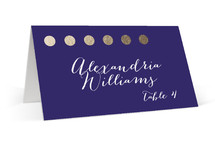 This is a purple wedding place card by design market called Yum with standard printing on signature in placecard.