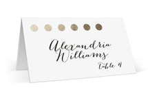 This is a gold wedding place card by design market called Yum with standard printing on signature in placecard.