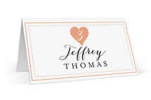 This is a pink wedding place card by Sarah Curry called Heartbeat with standard printing on signature in placecard.