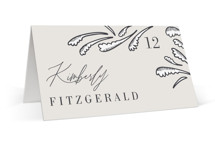 This is a beige wedding place card by Jen Owens called FancySchmancy with standard printing on signature in placecard.