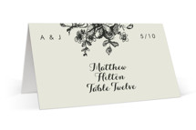 This is a beige wedding place card by Phrosne Ras called Elegance Illustrated with standard printing on signature in placecard.