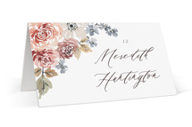 This is a red wedding place card by Wildfield Paper Co called Wildflower Garden with standard printing on signature in placecard.