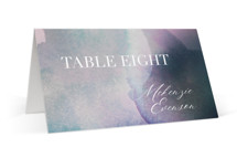 This is a purple wedding place card by Design Lotus called Raptured with standard printing on signature in placecard.