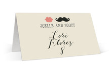 This is a white wedding place card by Penelope Poppy called Stache + Kiss with standard printing on signature in placecard.