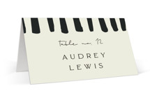 This is a black wedding place card by Morgan Kendall called Stripes with standard printing on signature in placecard.