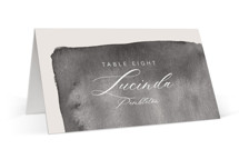 This is a grey wedding place card by Caitlin Considine called Midtown with standard printing on signature in placecard.