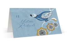 This is a blue wedding place card by Morgan Ramberg called The Love Birds with standard printing on signature in placecard.