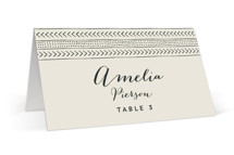 This is a beige wedding place card by Erin Deegan called mudcloth wedding with standard printing on signature in placecard.
