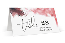 This is a pink wedding place card by Phrosne Ras called living coral with standard printing on signature in placecard.