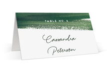 This is a green wedding place card by Yao Cheng Design called Evergreens Watercolor with standard printing on signature in placecard.